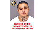 This undated booking photo released by the Merced County Sheriff's Office shows escapee inmate Jorge Barron, from Atwater, Calif. Authorities in central California are searching for six inmates, including Barron, who used a