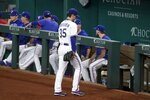 Texas Rangers starting pitcher Kohei Arihara (35) leaves the field after turning the ball over in the fifth inning of a baseball game against the Houston Astros in Arlington, Texas, Wednesday, Sept. 15, 2021. (AP Photo/Tony Gutierrez)