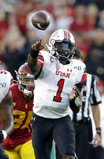 Utah quarterback Tyler Huntley (1) throws a pass against Southern California during the first half of an NCAA college football game Friday, Sept. 20, 2019, in Los Angeles. (AP Photo/Marcio Jose Sanchez)