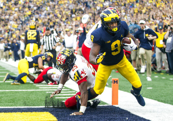 Michigan wide receiver Donovan Peoples-Jones (9) scores a 34-yard touchdown past Maryland defensive back Antoine Brooks Jr. (25)  in the third quarter of an NCAA college football game in Ann Arbor, Mich., Saturday, Oct. 6, 2018. Michigan won 42-21. (AP Photo/Tony Ding)