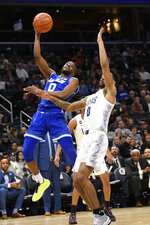 Seton Hall guard Quincy McKnight, left, shoots next to Georgetown guard Jahvon Blair (0) during the first half of an NCAA college basketball game, Wednesday, Feb. 5, 2020, in Washington. (AP Photo/Nick Wass)