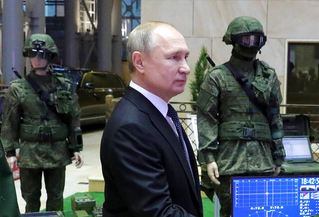 Russian President Vladimir Putin arrives to attend an annual meeting with top military officials in the National Defense Control Center in Moscow, Russia, Tuesday, Dec. 24, 2019.Putin said that Russia is the only country in the world that has hypersonic weapons even though its military spending is a fraction of the U.S. military budget. (Mikhail Klimentyev, Sputnik, Kremlin Pool Photo via AP)