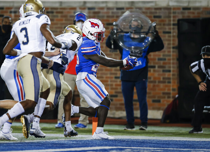 SMU running back Ulysses Bentley IV (26) scores a touchdown as Navy cornerbacks Marcus Wiggins (2) and Cameron Kinley (3) defend during the first half of an NCAA college football game Saturday, Oct. 31, 2020, in Dallas. (AP Photo/Brandon Wade)