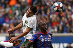 Portland Timbers midfielder Cristhian Paredes, left, heads the ball next to FC Cincinnati forward Kekuta Manneh (31) during the first half of an MLS soccer match Sunday, March 17, 2019, in Cincinnati. (AP Photo/John Minchillo)