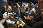 Brad Keselowski, left, answers questions from reporters during an interview at NASCAR Daytona 500 auto racing media day at Daytona International Speedway, Wednesday, Feb. 12, 2020, in Daytona Beach, Fla. (AP Photo/John Raoux)