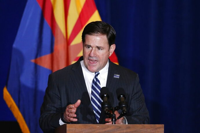 FILE - In this Tuesday, Aug. 11, 2020, file photo, Republican Arizona Gov. Doug Ducey speaks prior to Vice President Mike Pence speaking at the