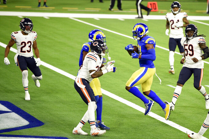 Los Angeles Rams tight end Gerald Everett, right, runs into the end zone for a touchdown during the second half of an NFL football game against the Chicago Bears Monday, Oct. 26, 2020, in Inglewood, Calif. (AP Photo/Kelvin Kuo)