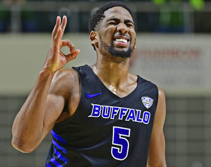 FILE - In this Tuesday, March 5, 2019, file photo, Buffalo guard CJ Massinburg reacts after making a 3-point shot during the second half of an NCAA college basketball game against Ohio in Athens, Ohio. On Friday, Massinburg will join four fellow seniors in playing their final home game, while appreciating how he played a significant role in spending the past four years placing Buffalo firmly on the map. (AP Photo/David Dermer, File)