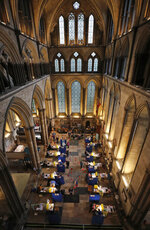 Fourteen tables are set up to provide the Pfizer-BioNTech vaccine inside Salisbury Cathedral in Salisbury, England, Wednesday, Jan. 20, 2021. Salisbury Cathedral opened its doors for the second time as a venue for the Sarum South Primary Care Network COVID-19 Local Vaccination Service. (AP Photo/Frank Augstein)