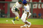 Kansas City Royals' Adalberto Mondesi (27) beats the tag by Oakland Athletics second baseman Tony Kemp (21) to steal second during the fourth inning of a baseball game Wednesday, Sept. 15, 2021, in Kansas City, Mo. (AP Photo/Charlie Riedel)