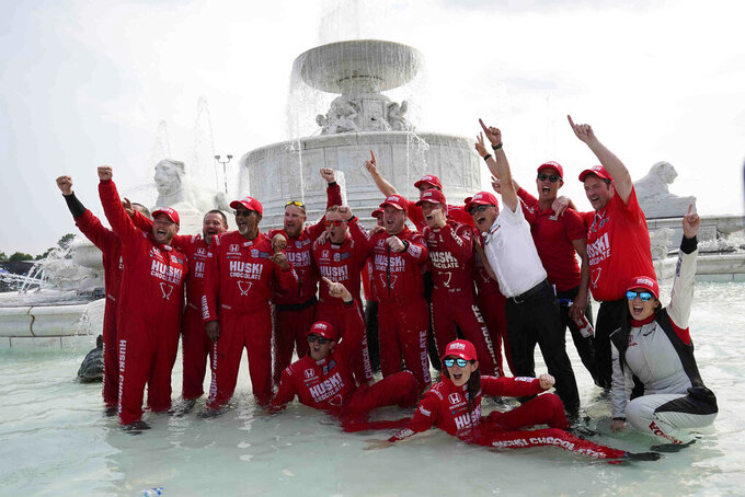Chip Ganassi engineer Angela Ashmore is shown sitting in the water, second from bottom right, next to Nicole Rotondo, an engineer with Honda Performance Development, bottom far right, as the team celebrates in a fountain after Marcus Ericsson of Sweden won the first race of the IndyCar Detroit Grand Prix auto racing doubleheader on Belle Isle in Detroit on Saturday, June 12, 2021. The last three IndyCar races have been won by drivers who have female engineers on their teams, a trend that could continue Sunday at Mid-Ohio Sports Car Course. (AP Photo/Paul Sancya)