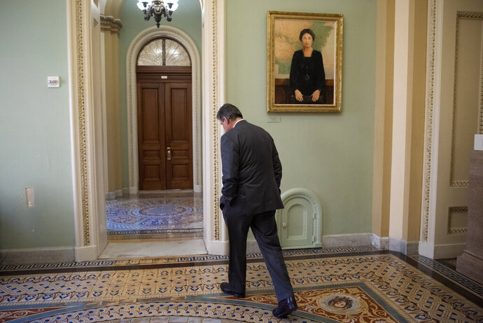 Sen. Joe Manchin, D-W.Va., walks away from the Senate chamber at the Capitol in Washington, Tuesday, Jan. 21, 2020. President Donald Trump'simpeachment trialquickly burst into a partisan fight Tuesday as proceedings began unfolding at the Capitol. (AP Photo/Cliff Owen)
