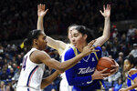 Tulsa's Kendrian Elliott (00) grabs a rebound from Connecticut's Aubrey Griffin (44) during the first half of an NCAA college basketball game Sunday, Jan. 19, 2020, in Storrs, Conn. (AP Photo/Stephen Dunn)