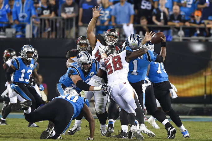 Tampa Bay Buccaneers linebacker Shaquil Barrett (58) sacks Carolina Panthers quarterback Cam Newton (1) during the second half of an NFL football game in Charlotte, N.C., Thursday, Sept. 12, 2019. (AP Photo/Mike McCarn)