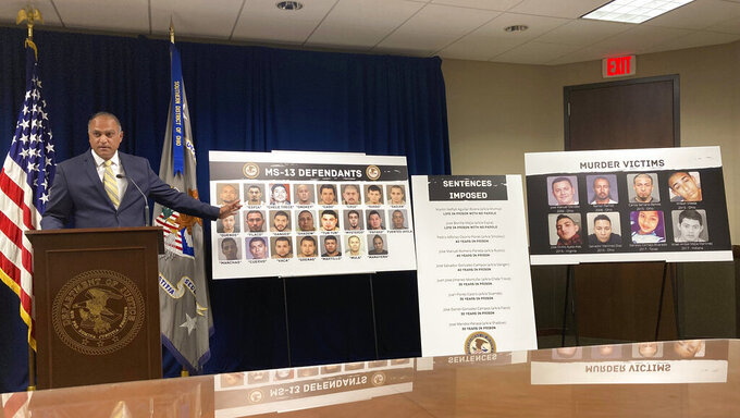 Vipal Patel, acting U.S. Attorney for the Southern District of Ohio, discusses the case brought against 23 central Ohio members of the El Salvador-based MS-13 gang, on Thursday, July 29, 2021, in Columbus, Ohio. Patel said 22 of the gang members have now been convicted with the prosecution resolving eight homicides. A 23rd gang member is a fugitive in El Salvador. (AP Photo/Andrew Welsh-Huggins)