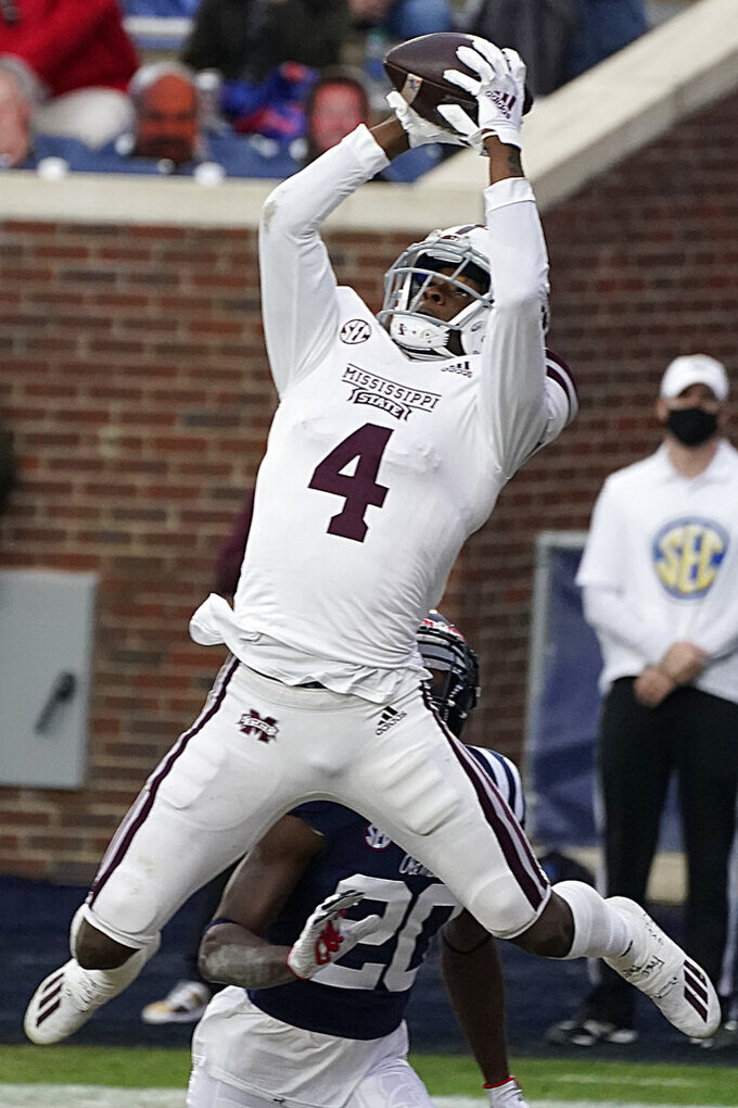 Mississippi State wide receiver Malik Heath (4) reaches for a touchdown pass during the first half of an NCAA college football game against Mississippi, Saturday, Nov. 28, 2020, in Oxford, Miss. (AP Photo/Rogelio V. Solis)