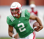 FILE - In this Aug. 8, 2018, file photo, Nebraska quarterback Adrian Martinez  runs with the ball during NCAA college football fall practice in Lincoln, Neb. True freshmen Zack Annexstad of Minnesota, Arthur Sitkowski of Rutgers and Adrian Martinez of Nebraska are the starting quarterbacks for their teams' openers. (AP Photo/Nati Harnik, File)