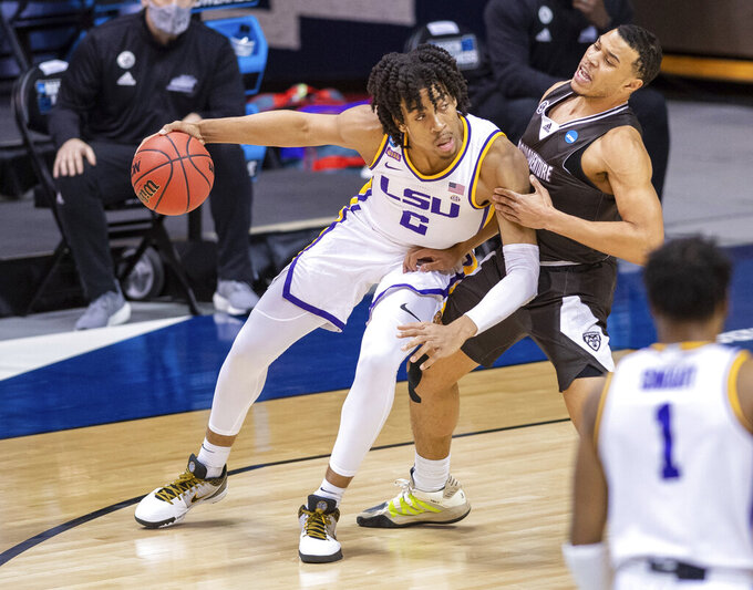 LSU forward Trendon Watford (2) makes contact with St. Bonaventure guard Jaren Holmes (5) as he works the ball in toward the basket during the first half of a first round game in the NCAA men's college basketball tournament, Saturday, March 20, 2021, at Assembly Hall in Bloomington, Ind. (AP Photo/Doug McSchooler)