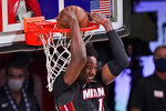 Miami Heat's Bam Adebayo (13) slams home a backward dunk during the second half of an NBA conference final playoff basketball game Sunday, Sept. 27, 2020, in Lake Buena Vista, Fla. (AP Photo/Mark J. Terrill)