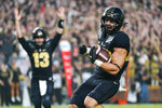 Purdue running back Zander Horvath (40) celebrates a touchdown with quarterback Jack Plummer (13) against Oregon State during the first half of an NCAA college football game in West Lafayette, Ind., Saturday, Sept. 4, 2021. (AP Photo/Michael Conroy)