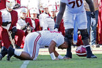 Alabama sive lineman Alex Leatherwood (70) checks on quarterback Tua Tagovailoa (13) after he was injured in the first half of an NCAA college football game against Mississippi State in Starkville, Miss., Saturday, Nov. 16, 2019. Alabama won 38-7. (AP Photo/Rogelio V. Solis)