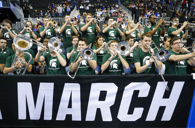 Members of the Michigan State band practice before the East Regional semifinal in the NCAA men's college basketball tournament between Michigan State and LSU, Friday, March 29, 2019, in Washington. (AP Photo/Patrick Semansky)