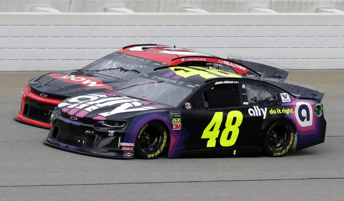 Jimmie Johnson (48) and Austin Dillon compete during a NASCAR Cup Series auto race at Chicagoland Speedway in Joliet, Ill., Sunday, June 30, 2019. (AP Photo/Nam Y. Huh)