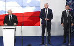 The leader of the Polish ruling party, Jaroslaw Kaczynskileft, speaks to reporters alongside and the leaders of two junior coalition partners, Jaroslw Gowin and Zbigniew Ziobro,right, in Warsaw, Poland, Saturday, Sept. 26, 2020. The three parties in Poland's conservative coalition government signed a new coalition agreement on Saturday, putting aside disagreements. But they gave no details, leaving lingering uncertainty about how the Cabinet will look in practice after an expected reshuffle.(AP Photo/Czarek Sokolowski)