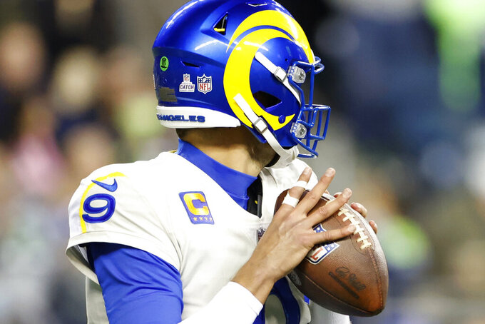 Los Angeles Rams quarterback Matthew Stafford (9) passes with tape on one of his fingers during the second half of an NFL football game against the Seattle Seahawks, Thursday, Oct. 7, 2021, in Seattle. (AP Photo/Craig Mitchelldyer)