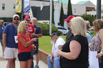 U.S. House District 14 candidate Marjorie Taylor Greene talks with attendees at a Back the Blue Rally in front of Rome City Hall on Monday, June 15, 2020 in Rome, Ga. Greene, in an Aug. 11 runoff for the Republican nomination in northwest Georgia's 14th Congressional District against John Cowan, has come under fire for remarks she made in videos she recorded. (Olivia Morley/Rome News-Tribune via AP)