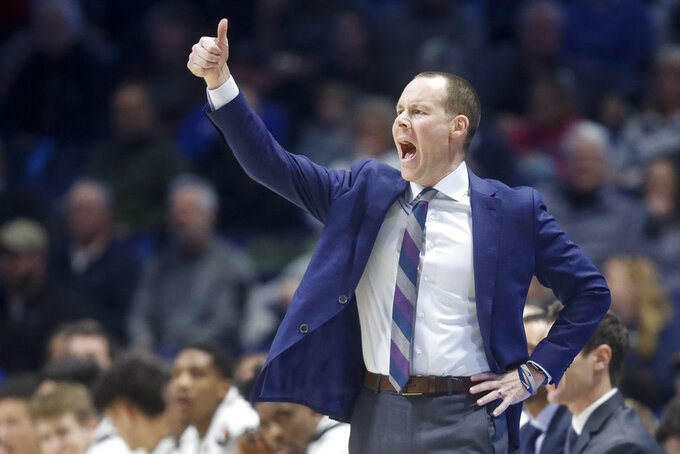 Xavier head coach Travis Steele directs his players from the bench during the first half of an NCAA college basketball game against Georgetown, Wednesday, Jan. 9, 2019, in Cincinnati. (AP Photo/John Minchillo)