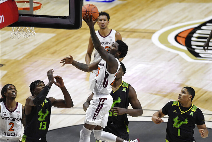 Virginia Tech's Tyrece Radford shoots in the second half of an NCAA college basketball game against South Florida, Sunday, Nov. 29, 2020, in Uncasville, Conn. (AP Photo/Jessica Hill)