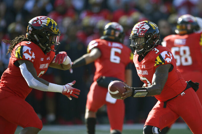 Maryland quarterback Tyrrell Pigrome (3) hands the ball off to Maryland running back Anthony McFarland (5) during the first half of an NCAA football game against Ohio State, Saturday, Nov. 17, 2018, in College Park, Md. (AP Photo/Nick Wass)