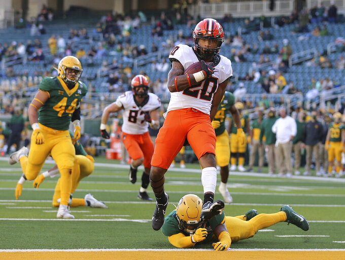 Oklahoma State running back Dominic Richardson (20) scores a touchdown past Baylor safety Christian Morgan (4) in the first half of an NCAA college football game, Saturday, Dec. 12, 2020, in Waco, Texas. (Jerry Larson/Waco Tribune-Herald via AP)