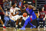 Iowa State guard Tre Jackson, left, fights for a loose ball with Kansas forward Silvio De Sousa during the second half of an NCAA college basketball game, Wednesday, Jan. 8, 2020, in Ames, Iowa. Kansas won 79-53. (AP Photo/Charlie Neibergall)