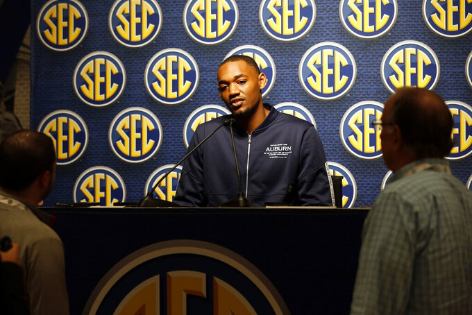 Auburn's Austin Wiley speaks during the Southeastern Conference NCAA college basketball media day, Wednesday, Oct. 16, 2019, in Birmingham, Ala. (AP Photo/Butch Dill)