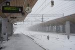 A empty platform at the train station in Umeaa, Sweden, Tuesday Jan. 12, 2021, as many trains are canceled due to the snow storm. Some thousands of households across northern Sweden and southern Finland are without power Wednesday Jan. 13, 2021, after heavy snowfall and icy temperatures swept across the region. (Erik Abel / TT via AP)