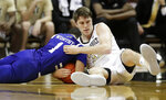 UNC Asheville guard Cress Worthy (1) and Vanderbilt forward Matt Ryan fight for the ball in the second half of an NCAA college basketball game Monday, Dec. 31, 2018, in Nashville, Tenn. (AP Photo/Mark Humphrey)