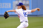 Los Angeles Dodgers starting pitcher Dustin May throws to the plate during the first inning of a baseball game against the San Diego Padres Monday, Aug. 10, 2020, in Los Angeles. (AP Photo/Mark J. Terrill)