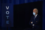 Democratic presidential candidate former Vice President Joe Biden listens during an event at Beech Woods Recreation Center, in Southfield, Mich., Friday, Oct. 16, 2020. (AP Photo/Carolyn Kaster)