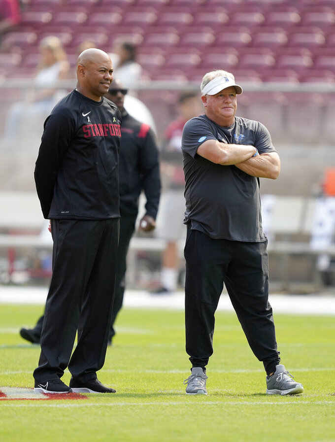 Stanford head coach David Shaw, left, talks with UCLA head coach Chip Kelly before an NCAA college football game Saturday, Sept. 25, 2021, in San Francisco, Calif. (AP Photo/Tony Avelar)