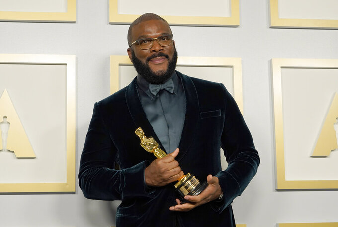 Tyler Perry, winner of the Jean Hersholt Humanitarian Award, poses in the press room at the Oscars on Sunday, April 25, 2021, at Union Station in Los Angeles. (AP Photo/Chris Pizzello, Pool)