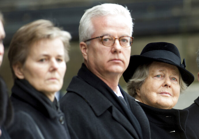 FILE -- In this Feb. 11, 2015 photo, from left, the children Beatrice von Weizsäcker and Fritz von Weizsaecker and the wife Marianne von Weizsaecker attend the funeral for the former German President Richard von Weizsaecker in Berlin, Germany. Fritz von Weizsaecker has been killed on Tuesday, Nov. 19, 2019 while he was giving a lecture at a hospital in Berlin where he also worked as a physician. (Maurizio Gambarini/dpa via AP, file)