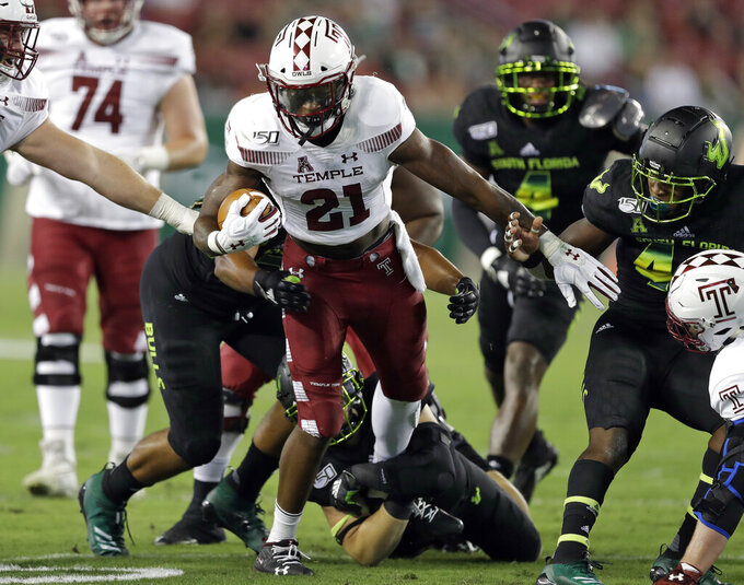 Temple running back Jager Gardner (21) picks up yardage against South Florida during the first half of an NCAA college football game Thursday, Nov. 7, 2019, in Tampa, Fla. (AP Photo/Chris O'Meara)