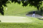 Collin Morikawa waits to putt on the 17th hole during the second round of the Workday Charity Open golf tournament, Friday, July 10, 2020, in Dublin, Ohio. (AP Photo/Darron Cummings)