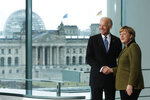 File---File picture taken Friday, Feb. 1, 2013. German Chancellor Angela Merkel, right, and United States' Vice President Joe Biden briefing the media prior to a meeting at the chancellery in Berlin, Germany.  Building in the background is the Reichstag, that hosts the German parliament. (AP Photo/Markus Schreiber,file)