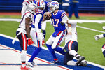 Buffalo Bills quarterback Josh Allen (17) breaks a tackle by New England Patriots' Byron Cowart to score a touchdown during the second half of an NFL football game Sunday, Nov. 1, 2020, in Orchard Park, N.Y. (AP Photo/Adrian Kraus)