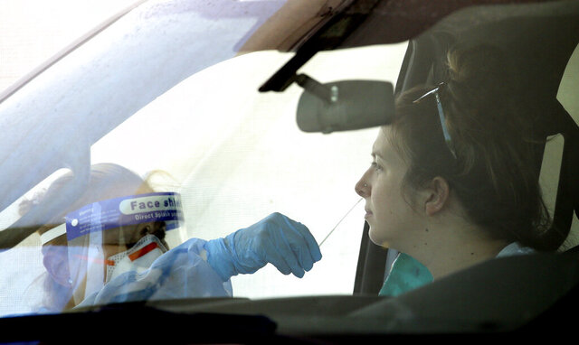 People get tested at a drive thru coronavirus testing site at South Mountain Community College, Thursday, July 9, 2020, in Phoenix. (AP Photo/Ross D. Franklin)