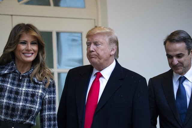 President Donald Trump, accompanied by first lady Melania Trump, turns with Greek Prime Minister Kyriakos Mitsotakis to walk to the Oval Office of the White House, Tuesday, Jan. 7, 2020, in Washington. (AP Photo/Alex Brandon)