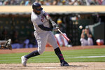 Cleveland Indians' Franmil Reyes hits a solo home run against the Oakland Athletics during the eighth inning of a baseball game Saturday, July 17, 2021, in Oakland, Calif. (AP Photo/Tony Avelar)